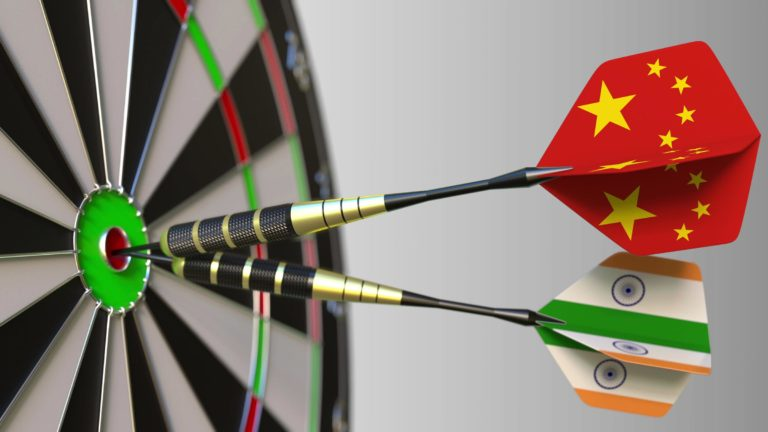 Darts with China and India flags on a dartboard