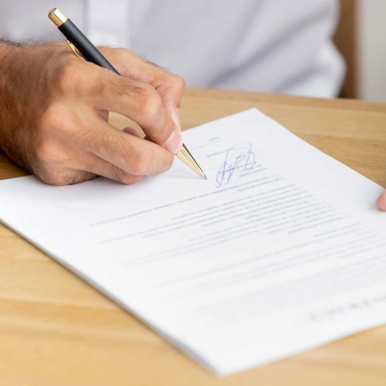 Person signing a contract agreement